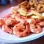 Creveti si calamari in sos de rosii si bere